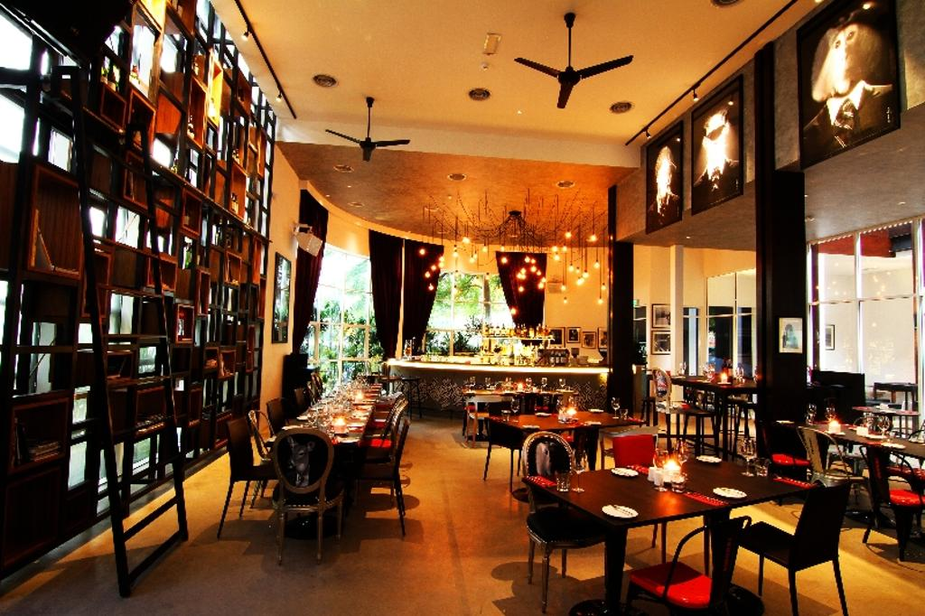 Renoma Cafe KL, Commercial, Architect, Aamer Architects, Contemporary, Ceiling Fan, Black Ceiling Fan, Warm Lighting, Red Black Chairs, Hanging Lights, Open Shelf, High Shelves, Open Shelves, Cafe, Restaurant, Pub