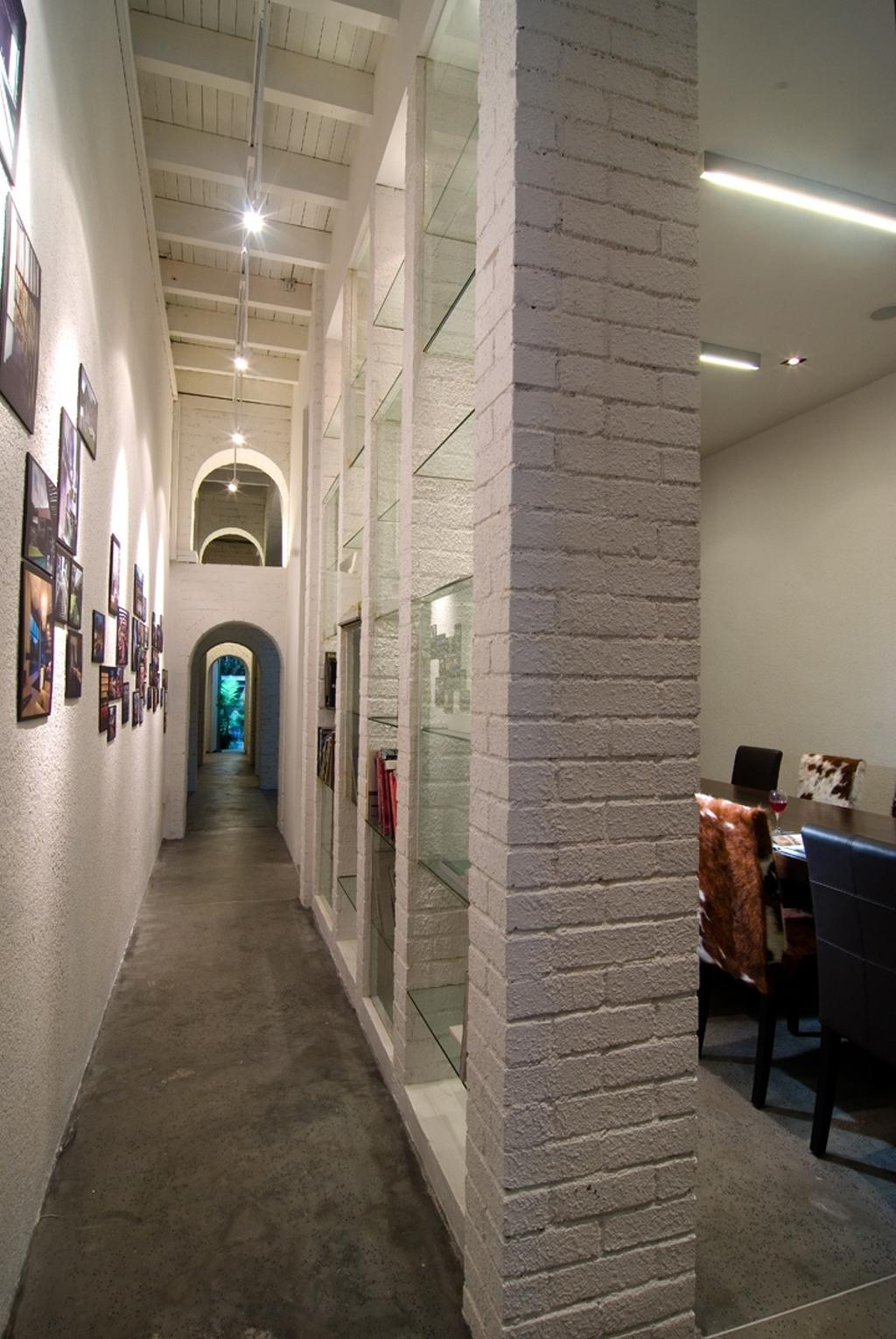 Sophia Office, Commercial, Architect, Aamer Architects, Contemporary, White Beam Ceiling, Beam Ceiling, White Ceiling, Concrete Floor, Wall Art, Wall Portrait, Portrait, Brick Wall, Arched Doors, Open Doors, Couch, Furniture, Corridor