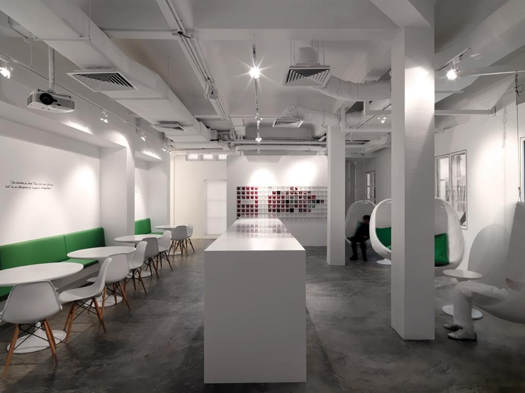 Leo Burnett, Commercial, Architect, Ministry of Design, Eclectic, White Pillar, White Counter, Concrete Floor, White Ceiling, Green Cushioned Seats, White Tables, White Chairs, Ceiling Lighting, White Pillars, Chair, Furniture, Lighting, Dining Table, Table