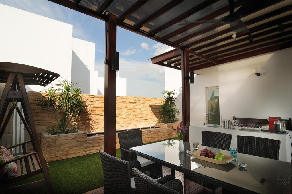 Transitional, Condo, Living Room, Livia, Interior Designer, The Orange Cube, Outdoors, Veranda, Dining Table, Rattan, Chair, Swing, Brick Wall, Raw, Awning, Columns, Furniture, Porch, Building, House, Housing, Villa, Flora, Jar, Plant, Potted Plant, Pottery, Vase