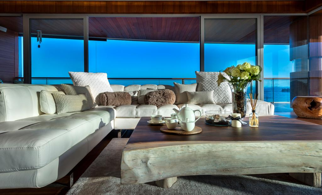 Traditional, Condo, Living Room, Oceanfront, Interior Designer, akiHAUS, Deck, Ceiling, White, Leather, Sofa, Coffee, Table, Flower, Vase, Full Length Window, Rug, Nature, Chair, Furniture, Couch